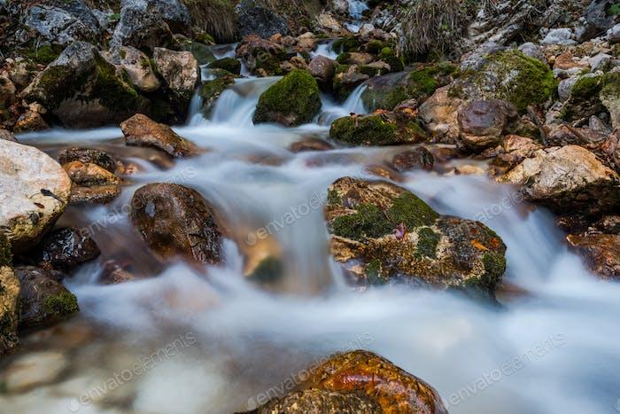 Water flow in wild mountain creek, long exposure