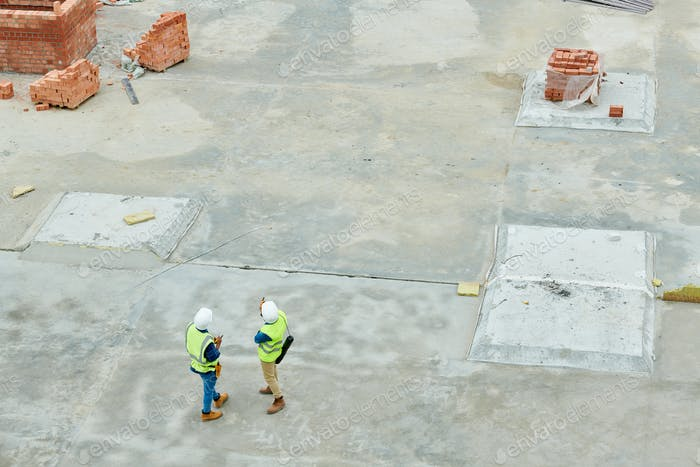 Builders working at construction site