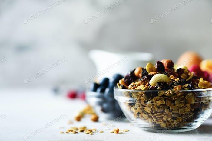 Homemade granola with milk, fresh berries, milk for breakfast. Copy space. Healthy breakfast concept