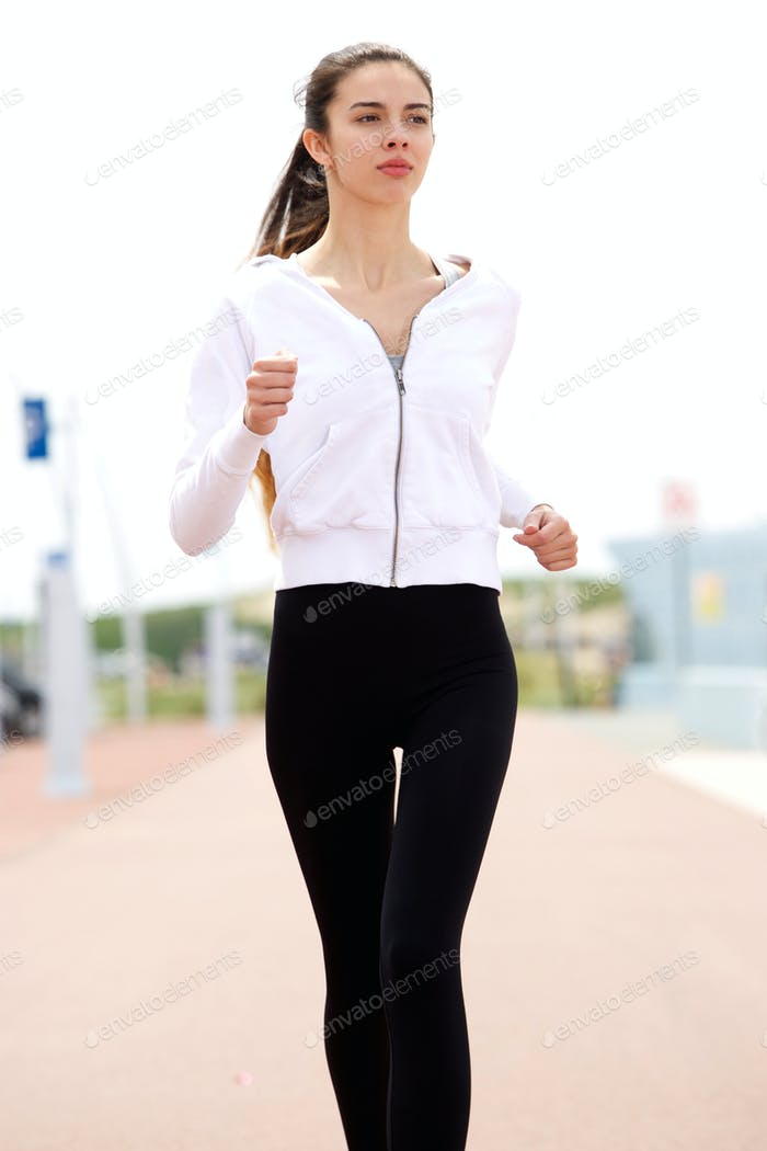 Young female runner outside