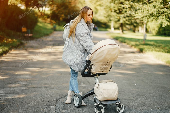 young mother pushing a stroller