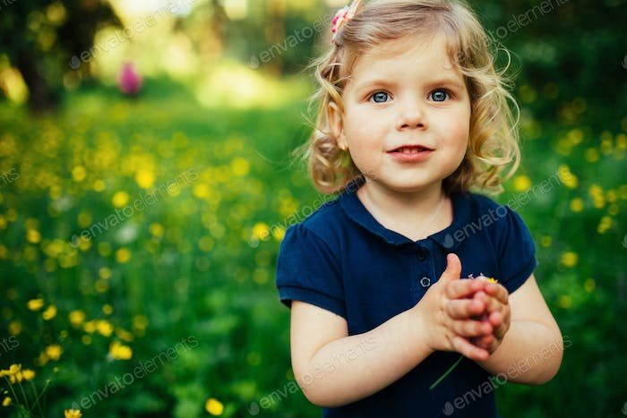 child playing outdoors in the grass