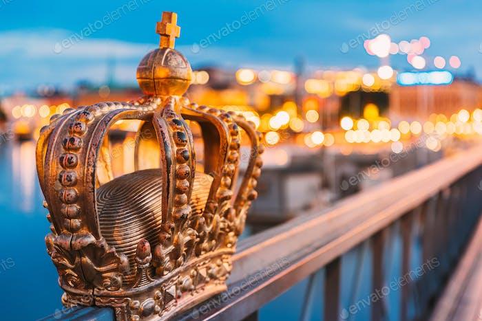 Stockholm, Sweden. Skeppsholmsbron - Skeppsholm Bridge With Its Famous Golden Crown In Night Lights