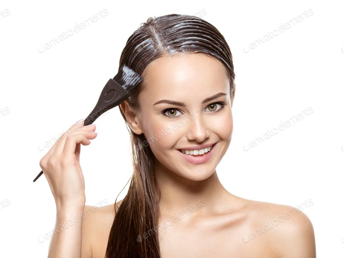 Smiling woman  coloring hair with brush