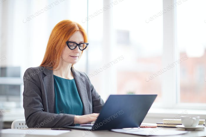 Modern Female Boss Using Laptop