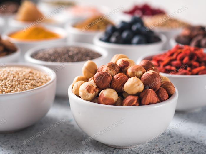 Hazelnut in small white bowl and other superfoods
