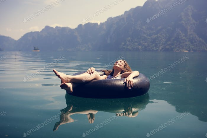 Woman relaxing on a floating ring