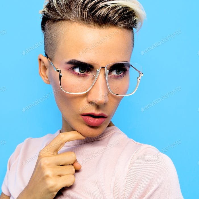 Tomboy Fashion Model in stylish accessories glasses. Trends eyew
