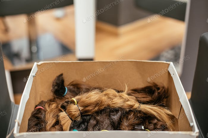 Box of braided hair for cancer donation