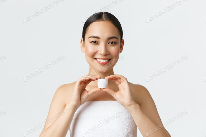 Beauty, personal care, spa salon and skincare concept. Close-up of beautiful smiling asian woman in