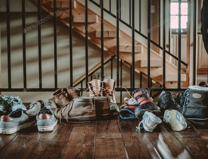Shoes by a Staircase