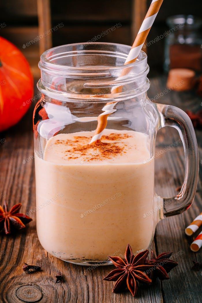 Pumpkin pie smoothie with cinnamon in mason jar