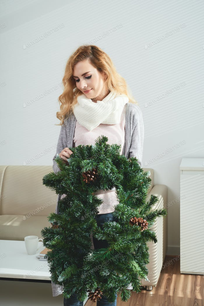 Woman with spruce wreath