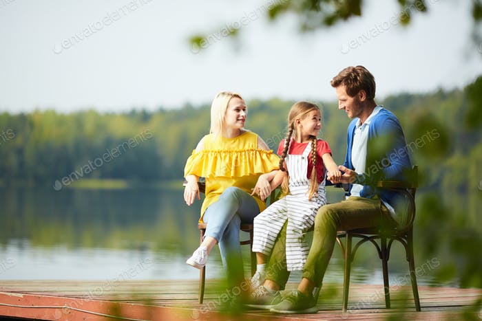 Family by waterside