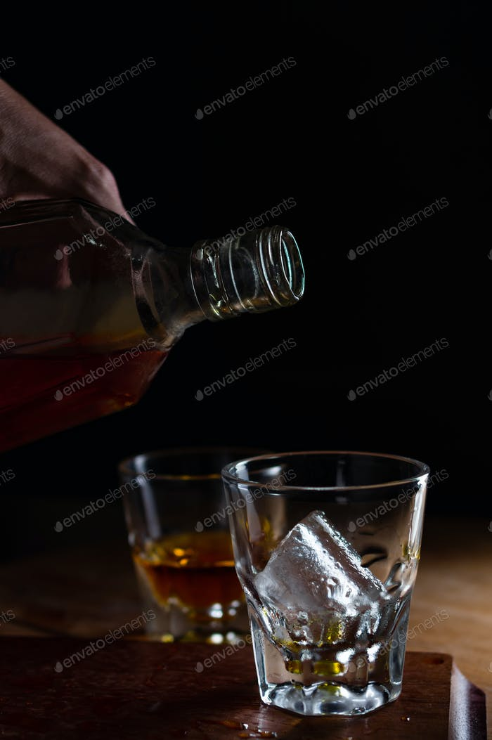Pouring the liquor to the glass