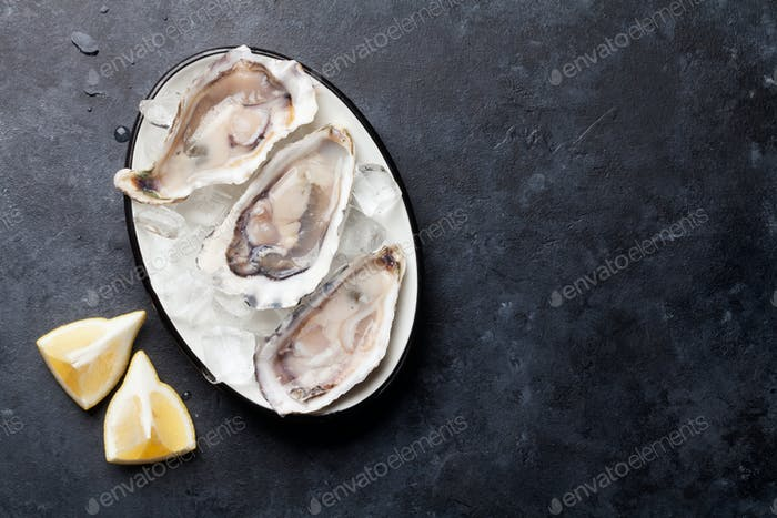 Opened oysters and lemon