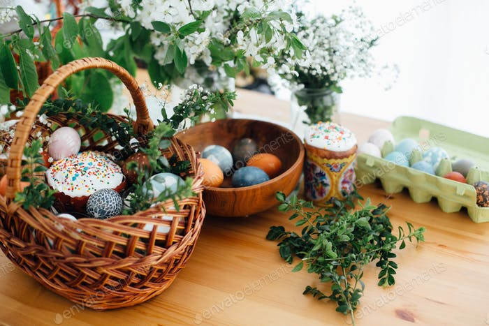 Easter modern eggs, easter bread, ham, beets, butter, in wicker basket