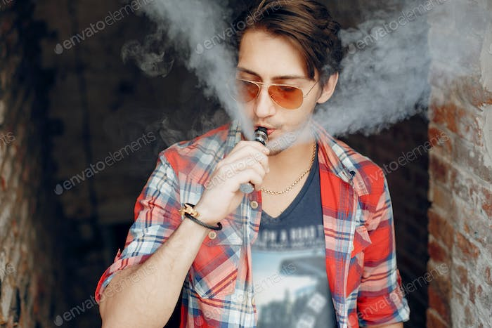 Thumbnail for Stylish and elegant man in a city with vape