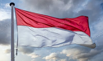 Indonesia flag waving against cloudy sky