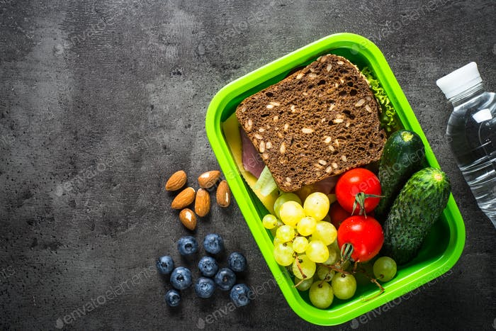 Lunch box with sandwich, fruit and vegetables