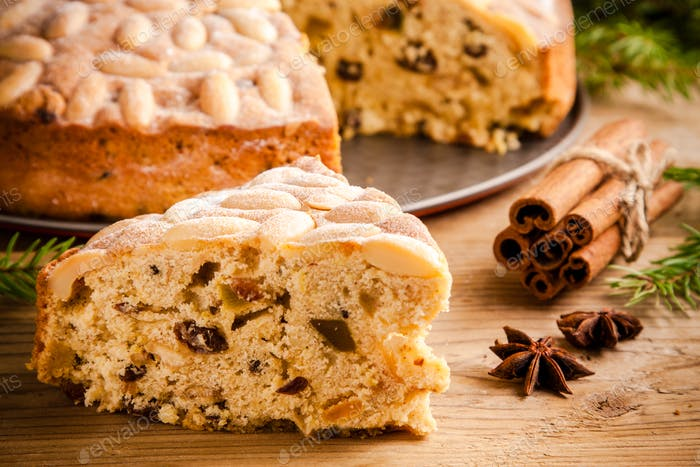 Dundee cake on a wooden table