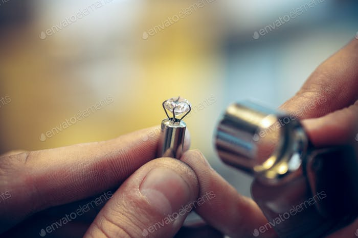 Different goldsmiths tools on the jewelry workplace. Jeweler at work in jewelry.