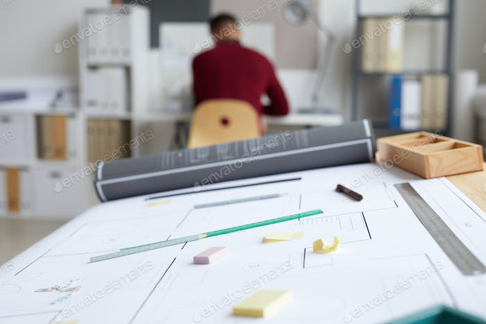 Plans on Architects Workplace Background