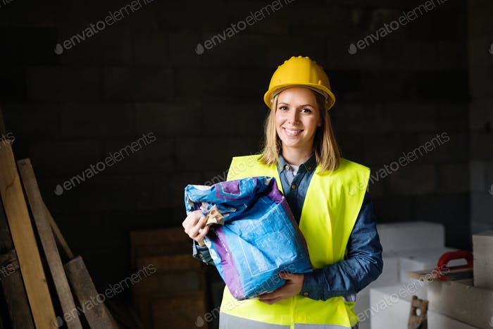 Young woman worker in a warehouse.