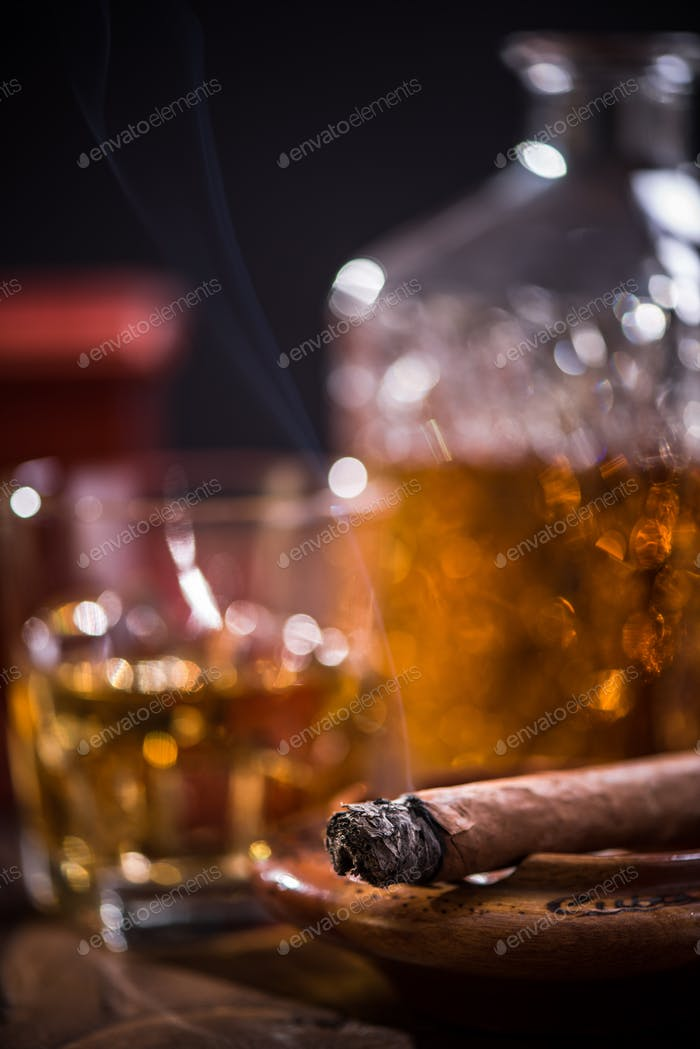 Cuban cigar and expensive alcohol in carafe