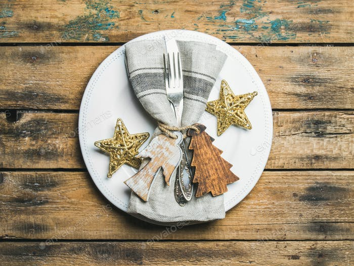 Christmas, New Year holiday table setting over rustic wooden background