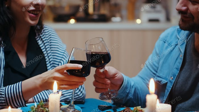 Couple with red wine glasses