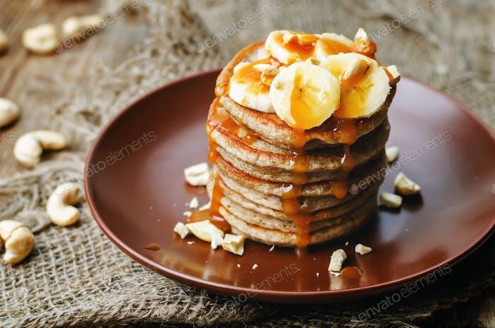 banana cashew pancakes with bananas and salted caramel sauce