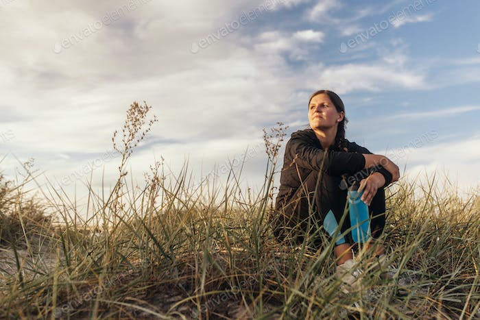 Young woman sitting in grass