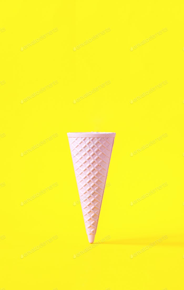 Minimalistic concept.Wafer ice cream cone  light pink colors
