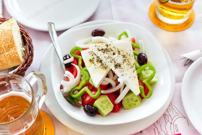 Thumbnail for Greek salad with fresh vegetables, feta cheese and black olives
