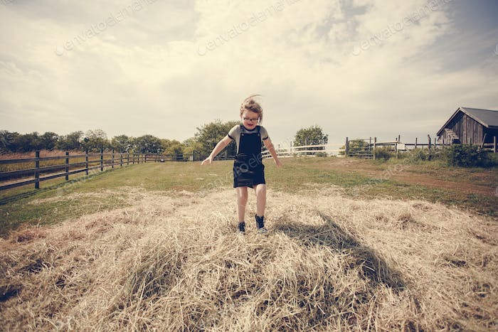 Little girl having fun in a farm