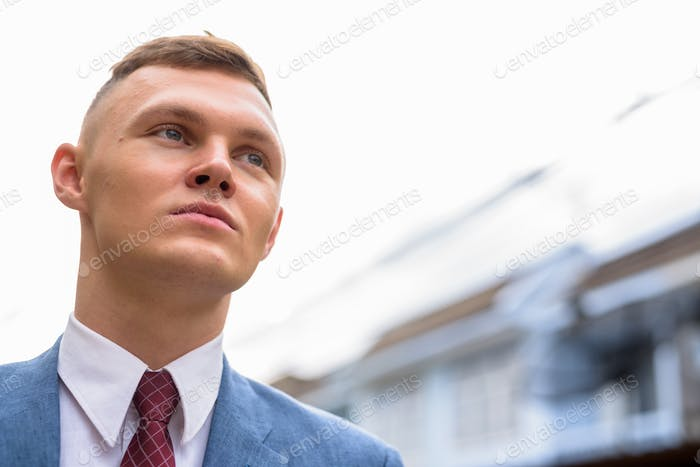 Portrait of young businessman in the streets outdoors
