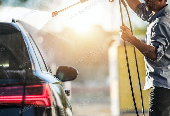 Car Wash Attendant Washing Clients Car.