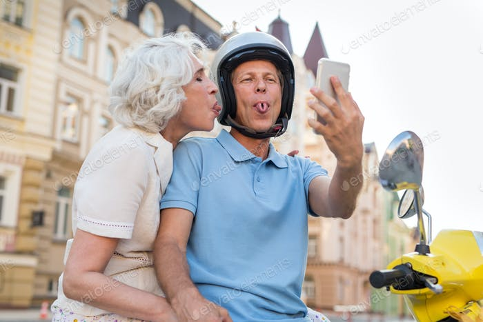 Mature couple showing tongues