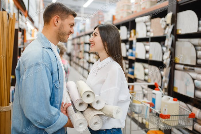 Couple choosing wallcovering in hardware store
