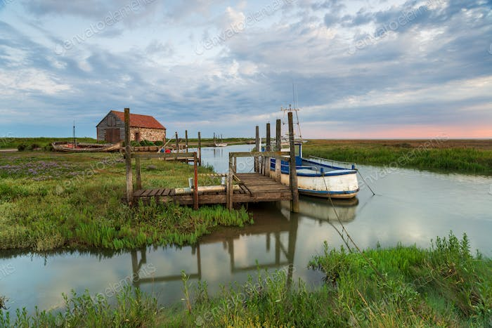 Dawn over the old harbour at Thornham