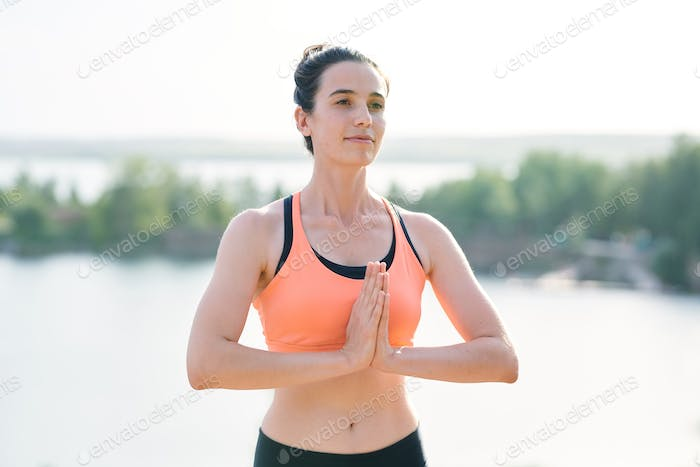 Content yoga coach welcoming students