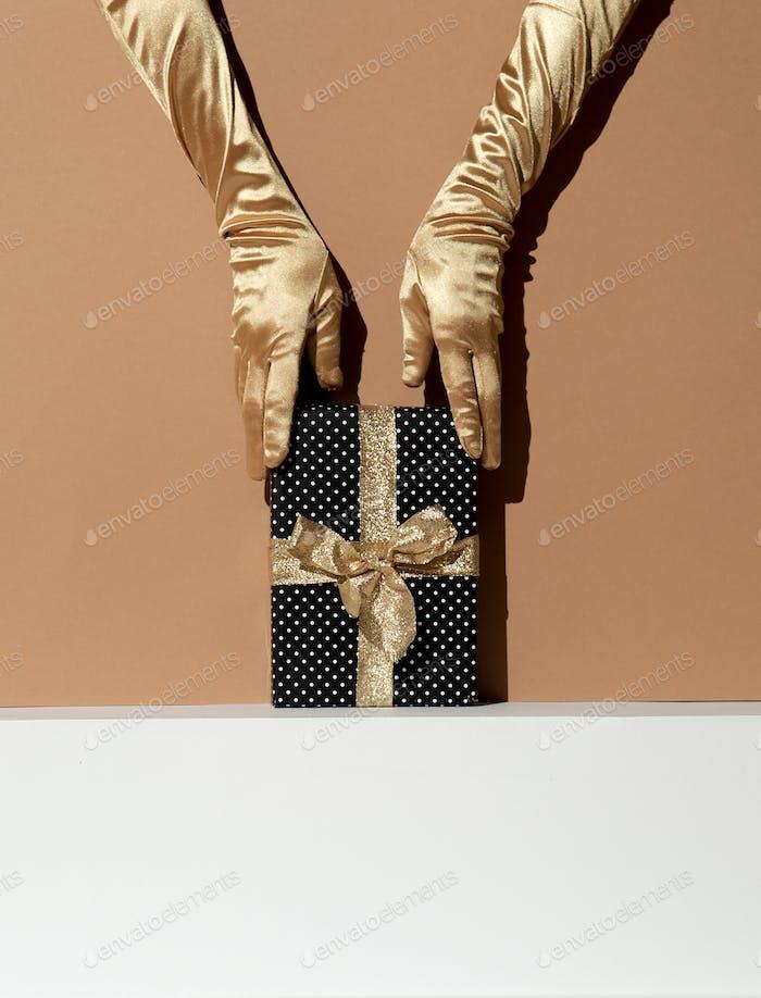 Hand in golden gloves