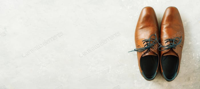 Top view of fashion male shoes on gray background. Sale and shopping concept. Copy space