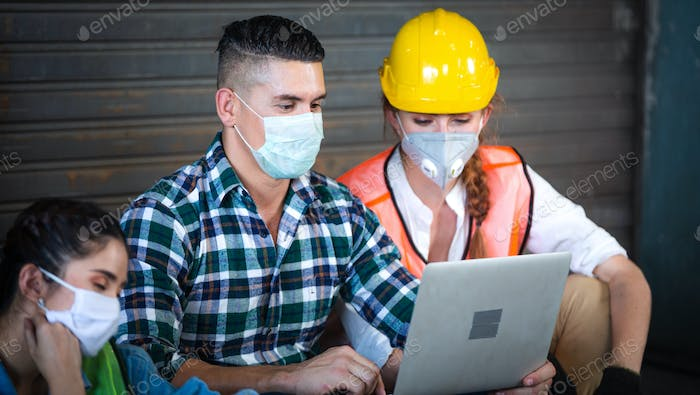 Construction worker watching project on laptop together or searching for new job