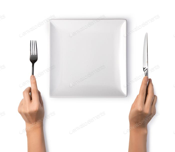 Woman hands holding a silver fork and knife
