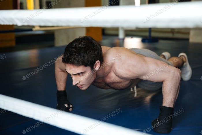 Boxer push ups in gym