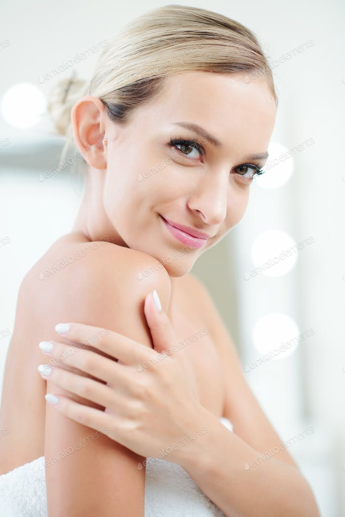 Smiling young woman after shower