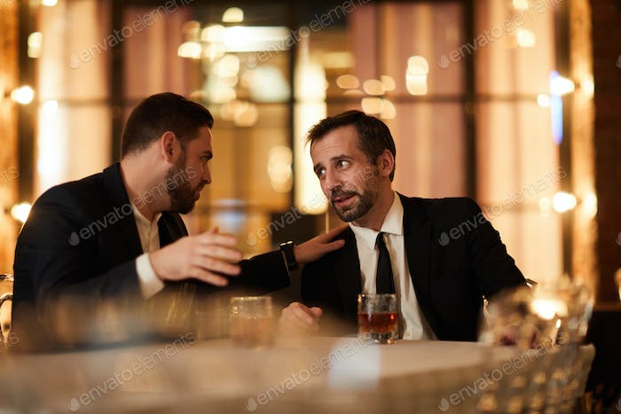 Two Business People Drinking in Restaurant