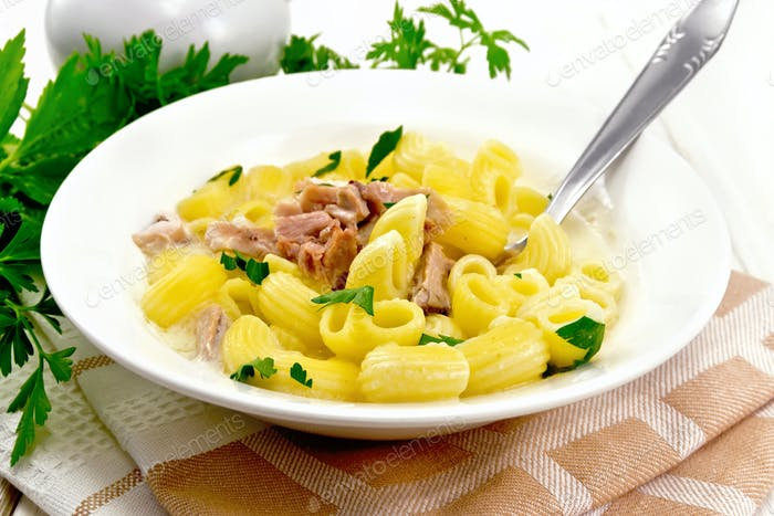 Soup creamy of chicken and pasta in plate on napkin